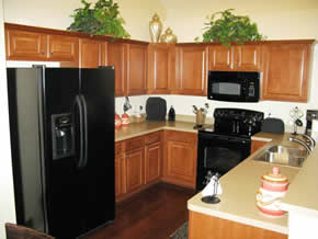 Kitchens With Black Appliances And Hardwood Floors